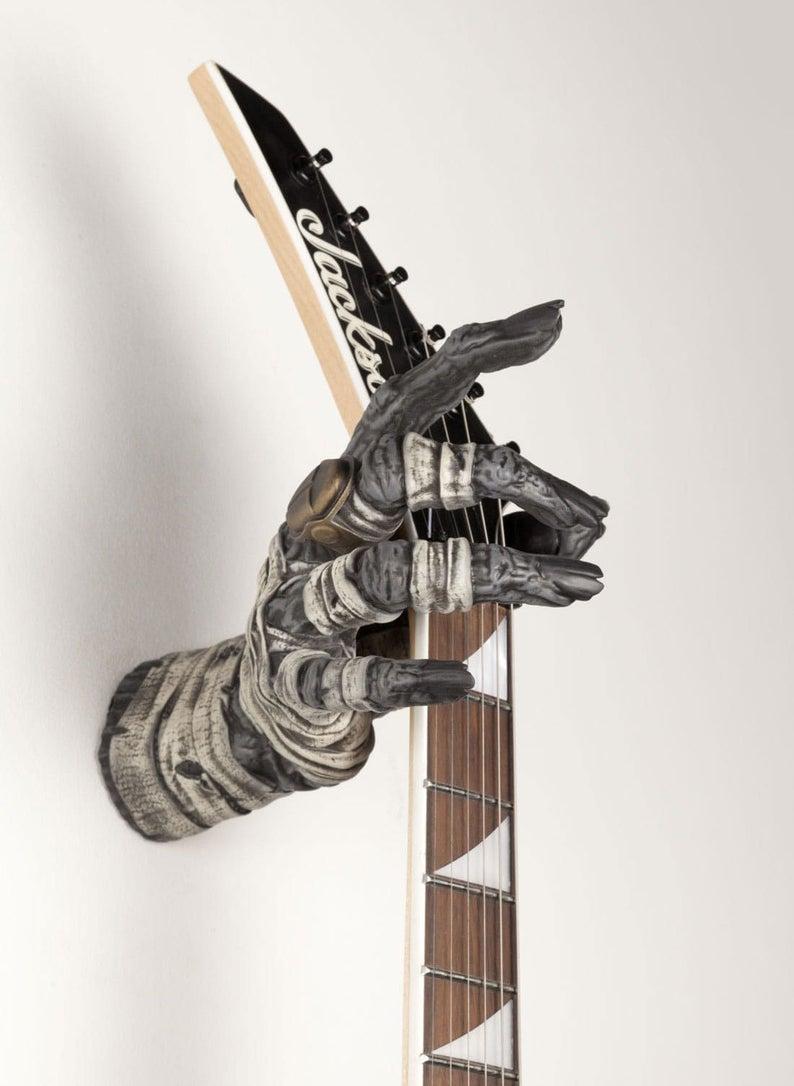 colgador mano guitarra