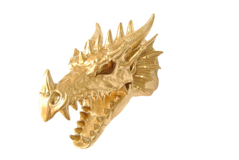 cabeza de dragón dorado para pared